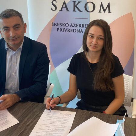 Gospodin Turkoglu, predsednik SAKOM-a i Jelena Rakić
