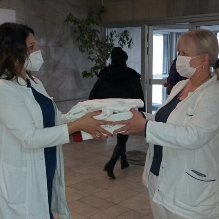The Hospital-Clinical Center KBC Zemun's health workers exchanging the received donation on the New Year's Eve Day.